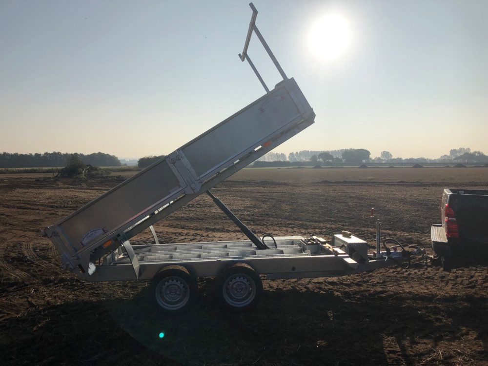 Tipping Trailer - tipped up with sun behind