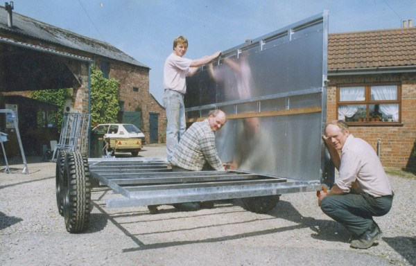 Graham Edwards, Martin Garside & Matthew Edwards assembling a livestock trailer in Bolton