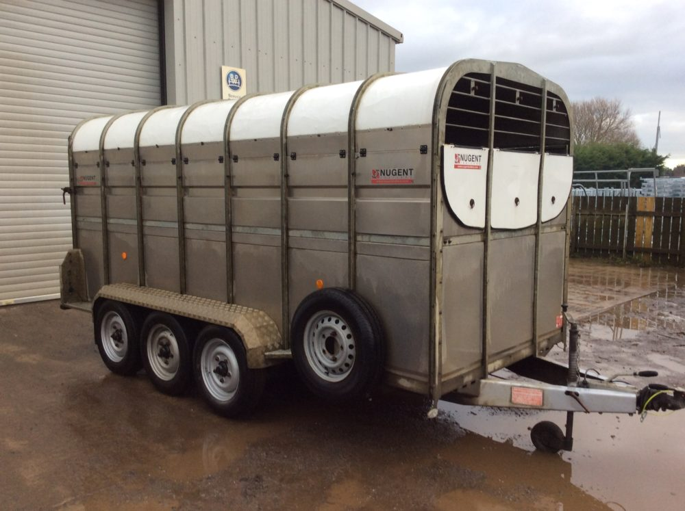 Nugent livestock trailer tri axle with wheels on the outside. Comes complete with 2 cattle partitions, front vents, LED lights & spare wheel.